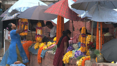 Orange flowers offers at Durbar Square Stock Video Footage