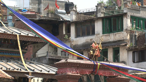 Statue and color flags at Durbar Square surrounded Stock Video Footage