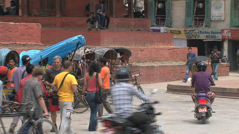 Busy crowd around bike taxis Stock Video Footage