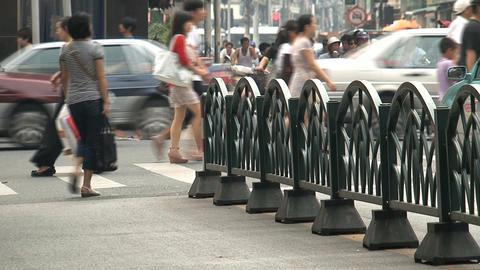 People crossing a pedestrian Footage