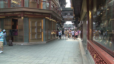 People in a street at the Yuyuan garden Footage
