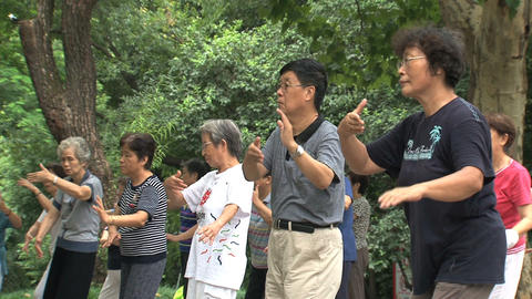 Group people doing Tai Chi close up Footage