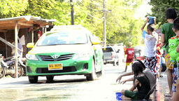 Children Splashing a Taxi During Songkran Festival Footage