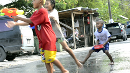 Children Having a Water Fight during the Songkran Festival Footage