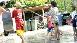 Children Having a Water Fight during the Songkran Festival Stock Video Footage