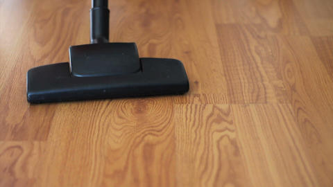 Vacuuming Laminate Flooring Close Up Footage