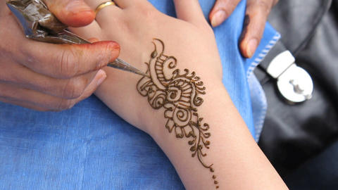 Woman Getting A Henna Tattoo On Her Wrist stock footage