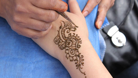 Woman Getting A Henna Tattoo On Her Wrist Stock Video Footage