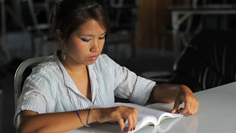 Young Asian Girl Reading Her Bible Stock Video Footage