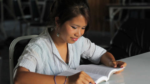 Young Asian Girl Reading Her Bible stock footage