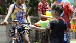 Young Boy with Water Pistol During Songkran Festival Stock Video Footage