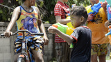 Young Boy with Water Pistol During Songkran Festival Footage
