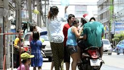 Splashing People on a Motorbike During Songkran Festival Stock Video Footage