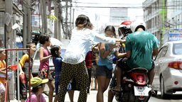 Splashing People on a Motorbike During Songkran Festival Footage