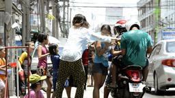 Splashing People on a Motorbike During Songkran Festival Footage