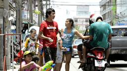 Splashing People on a Motorbike During Songkran Festival Stock Video Footage
