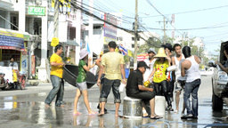 Songkran Water Fight - Throwing a Woman Into a Tub of Water Stock Video Footage