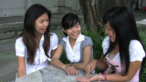 Three Asian Students Laughing stock footage