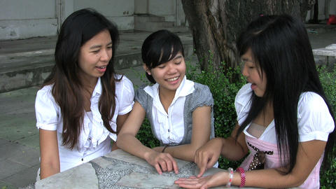 Three Asian Students Laughing Stock Video Footage