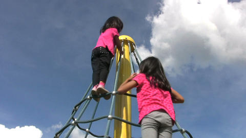 Two Girls Climb A Spinning Carousel stock footage