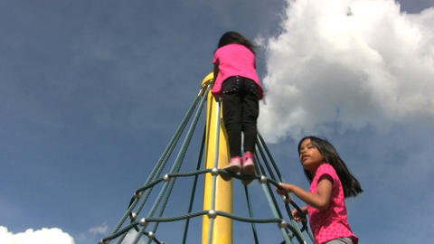 Two Girls Climb A Spinning Carousel Stock Video Footage