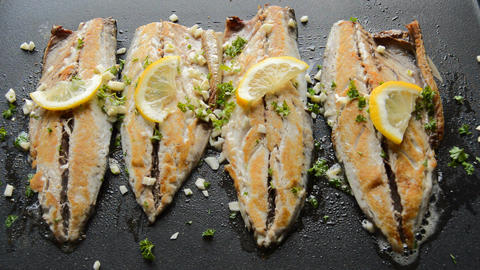Roasting Fish on a Pan with Condiments and Lemon Live Action