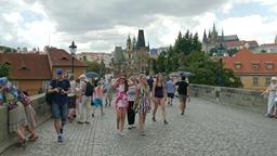 Prague, Czech Republic. People strolling at the Charles bridge Live Action
