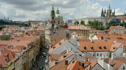 View of the street leading to the Charles bridge, Castle and the roofs of Prague Footage