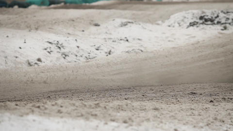 motorcycle rides on motocross track in winter Footage