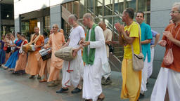 People from the Hare Krishna movement dancing and singing on the street 5 Footage