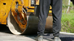 Road construction - Road roller compacting ground Footage