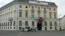 Horse cab on the street of Vienna and Federal Chancellery of Austria building Live Action