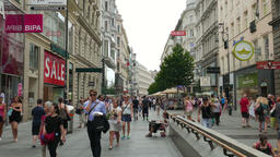 Crowd of people at Karntnerstrasse shopping street in Vienna, old town Footage