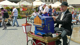 Man plays on barrel organ at the Market Place in the old town. Warsaw, Poland Footage