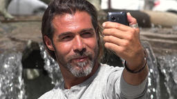Man Taking Selfy Using Cell Phone Live Action