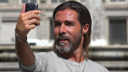 Male Tourist Taking Selfy Live Action