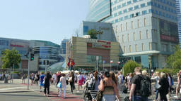 Busy pedestrian crossing in modern shopping center area. Warsaw downtown Footage