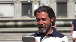 Man Walking Using Tablet Live Action