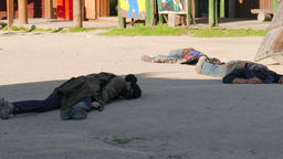 Three dead bank robbers lying on the street. American wid west Footage