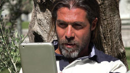 Man Reading Tablet Or Ebook Reader Footage