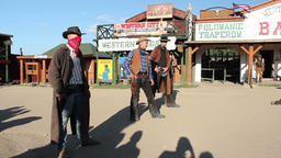 Shooting scene. Four gunslingers in action. American wild west Footage