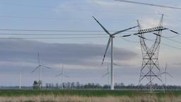 Wind turbines and power lines. Renewable energy sources Footage
