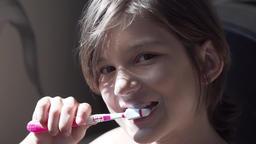 Girl brushing her teeth Slow Motion 240 Fps Footage