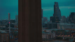 Panning across the financial City of London and St Pauls Cathedral during the bl Footage