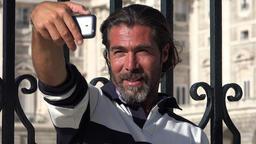 Man Taking Selfies Using Phone ビデオ
