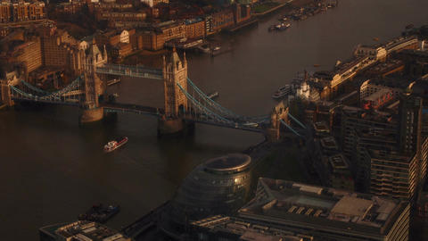 Aerial view of the London City Hall, Tower Bridge and the Thames during the gold Footage