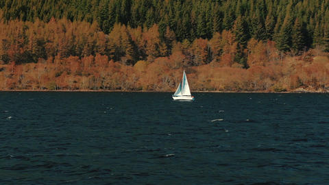 Small sailboat plying through Loch Ness in Scotland, UK Footage