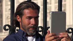 Man Filming Using Tablet Footage