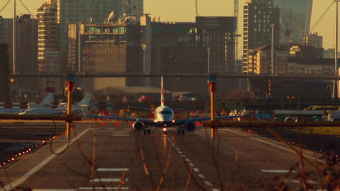 London City Airport - Large commercial airliner taking off and facing the camera Footage