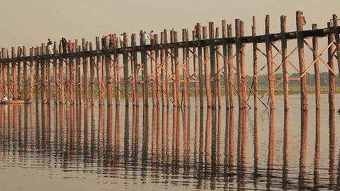people on famous U Bein Bridge at sunset in Amarapura, Myanmar Footage